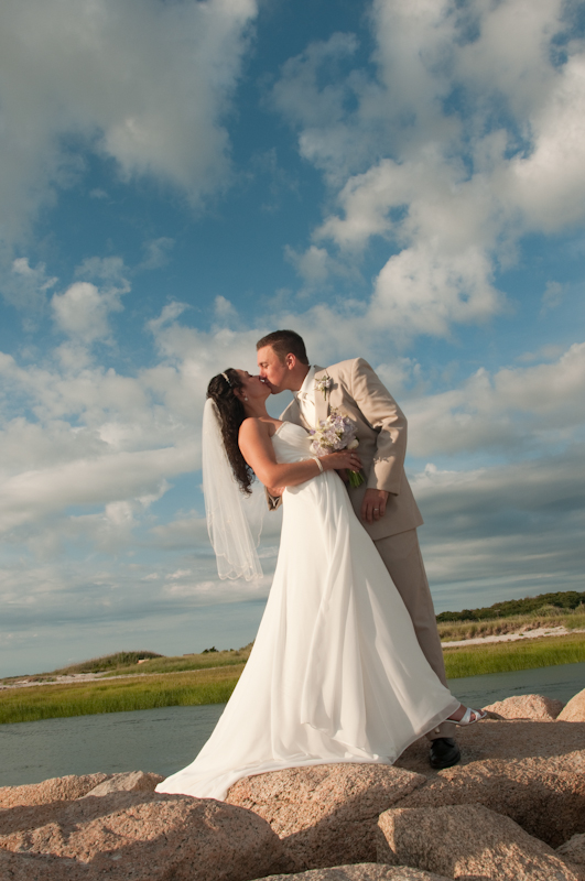 Wedding-couple-kissing-on-beach-rocks.jpg