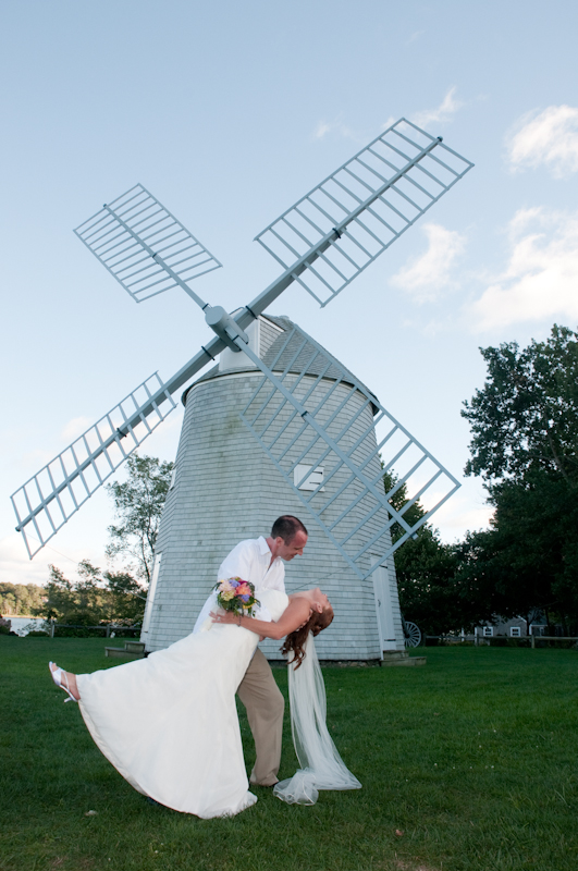 Groom-dipping-bride-in-front-of-windmill.jpg