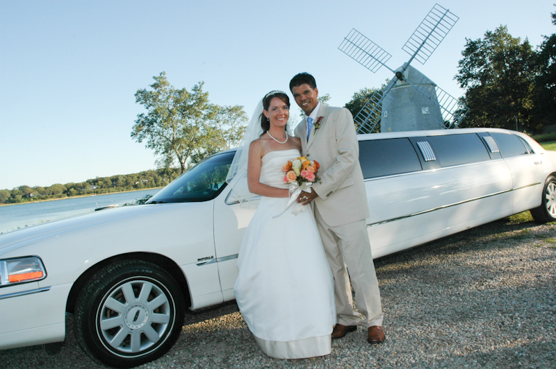 wedding-couple-in-front-of-Limousine.jpg