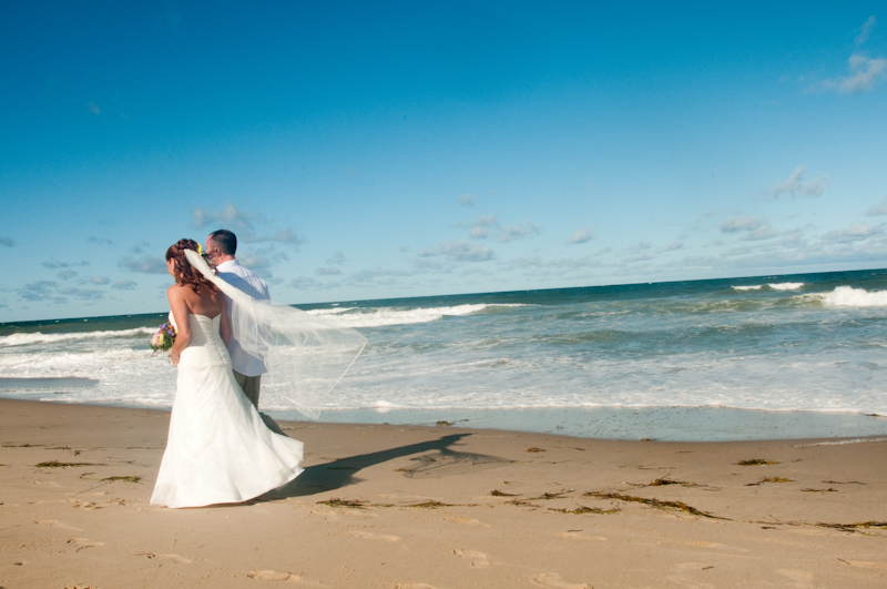 Wedding-couple-walking-on-beach.jpg